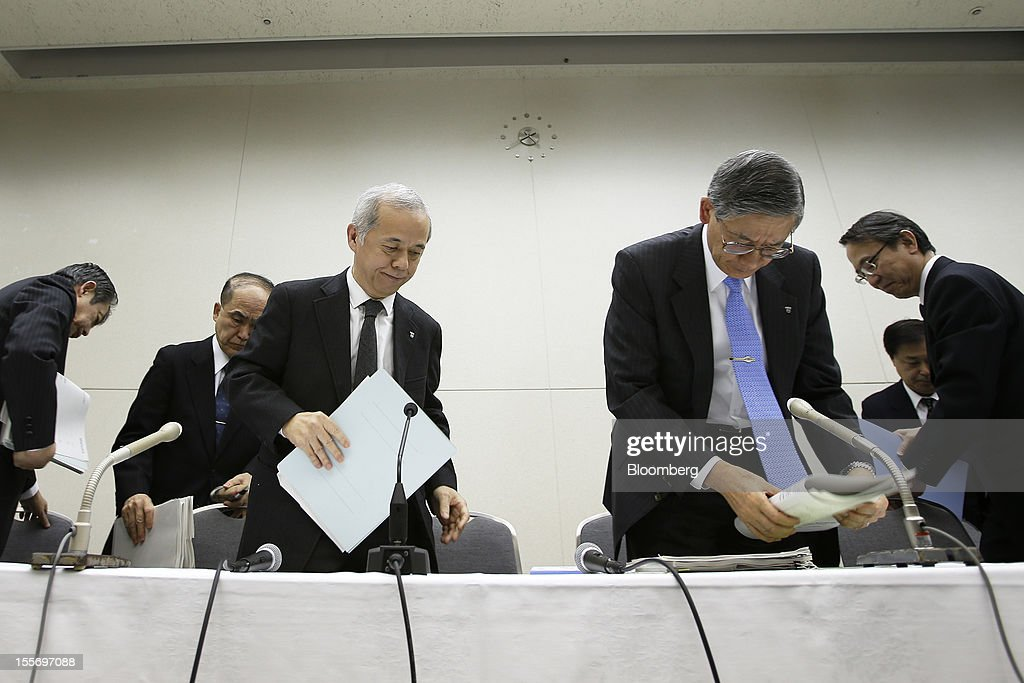 Naomi Hirose, president of Tokyo Electric Power Co. (Tepco), third from left, leaves a news conference at the company's headquarters in Tokyo, Japan, on Wednesday, Nov. 7, 2012. Tepco may ask the government for more funds to cover decontamination and reactor decommissioning costs from last year's nuclear disaster at its Fukushima Dai-Ichi atomic plant. Photographer: Kiyoshi Ota/Bloomberg via Getty Images