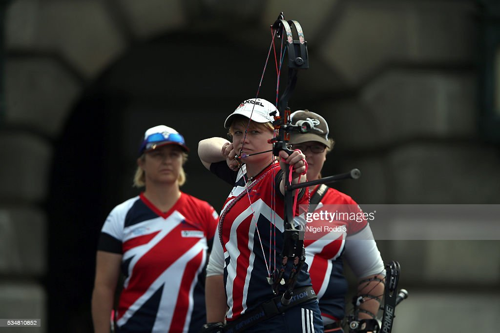 Naomi Jones (C) of Britain shoots during the Womens Compound Team Bronze medal team match at the European Archery Championship on May 28, 2016 in Nottingham, England.