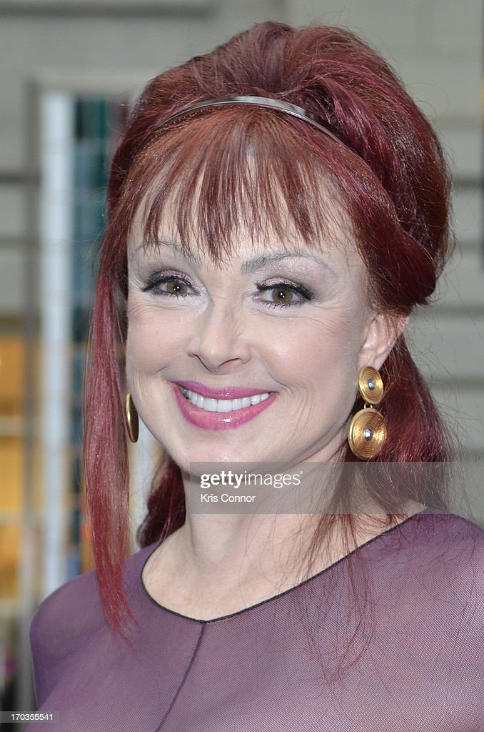 <a gi-track='captionPersonalityLinkClicked' href=/galleries/search?phrase=Naomi+Judd&family=editorial&specificpeople=206795 ng-click='$event.stopPropagation()'>Naomi Judd</a> poses for photos during a NCTA reception hosted by A+E Networks at Smithsonian American Art Museum & National Portrait Gallery on June 11, 2013 in Washington, DC.