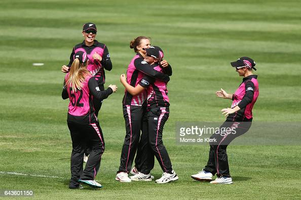 Naomi Kerr of New Zealand is congratulated by teammates after she took a catch to dismiss Alyssa Healy of Australia during the Women's Twenty20...
