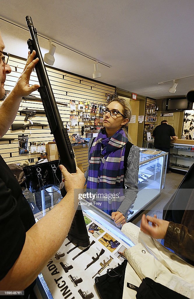 Naomi (last name withheld) looks at a shotgun to purchase for home protection at the 'Get Some Guns & Ammo' shooting range on January 15, 2013 in Salt Lake City, Utah. Lawmakers are calling for tougher gun legislation after recent mass shootings at an Aurora, Colorado movie theater and at Sandy Hook Elementary School in Newtown, Connecticut.