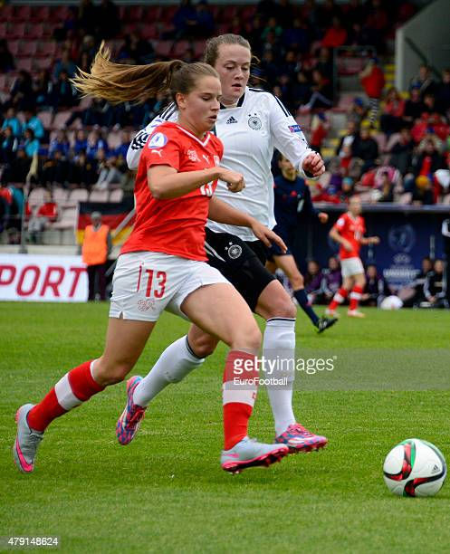 Naomi Megroz of Switzerland challenges Stefanie Sanders of Germany during the UEFA European Women's Under17 Championship semi final between U17...