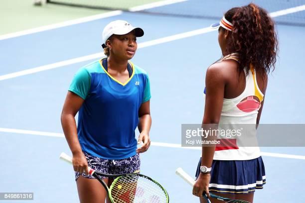 Naomi Osaka and Mari Osaka of Japan in action in her match against Makoto Ninomiya of Japan and Renata Voracova of Czech Republic during women's...