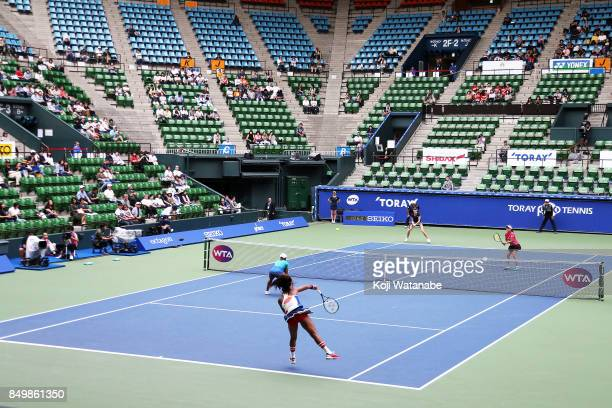 Naomi Osaka and Mari Osaka of Japan serves in her match against Makoto Ninomiya of Japan and Renata Voracova of Czech Republic during women's doubles...