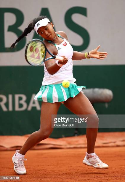 Naomi Osaka of Japan hits a forehand during the first round match against Alison Van Uytvanck of Belgium on day three of the 2017 French Open at...