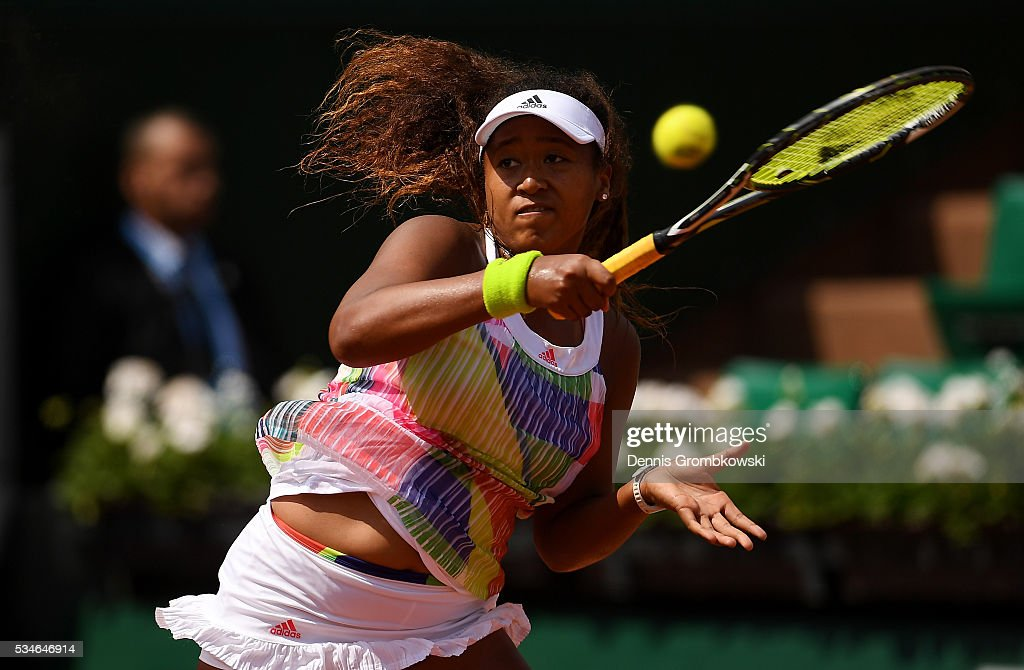 Naomi Osaka of Japan hits a forehand during the Ladies Singles third round match against Simona Halep of Romania on day six of the 2016 French Open at Roland Garros on May 27, 2016 in Paris, France.