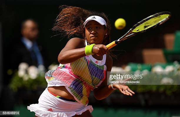 Naomi Osaka of Japan hits a forehand during the Ladies Singles third round match against Simona Halep of Romania on day six of the 2016 French Open...