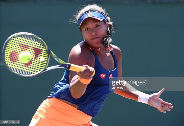 Naomi Osaka of Japan in action against Kristina Kucova of Slovakia during Day 2 of the Miami Open at Crandon Park Tennis Center on March 21 2017 in...