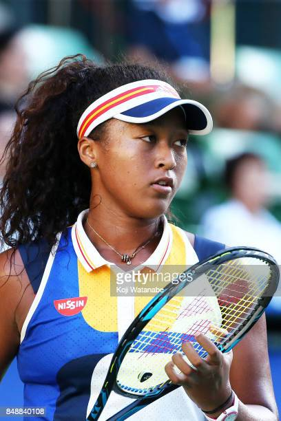 Naomi Osaka of Japan looks on in her match against Angelique Kerber of German during women's singles match day one of the Toray Pan Pacific Open...