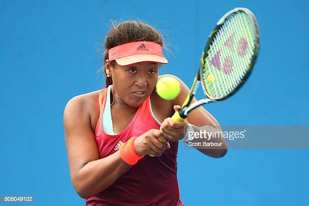 Naomi Osaka of Japan plays a backhand in her match against Alexandra Panova of Russia during round two of 2016 Australian Open Qualifying at...