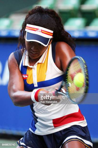 Naomi Osaka of Japan plays a backhand in her match against Angelique Kerber of German during women's singles match day one of the Toray Pan Pacific...