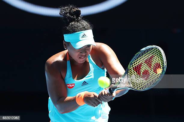 Naomi Osaka of Japan plays a backhand in her second round match against Johanna Konta of Great Britain on day four of the 2017 Australian Open at...