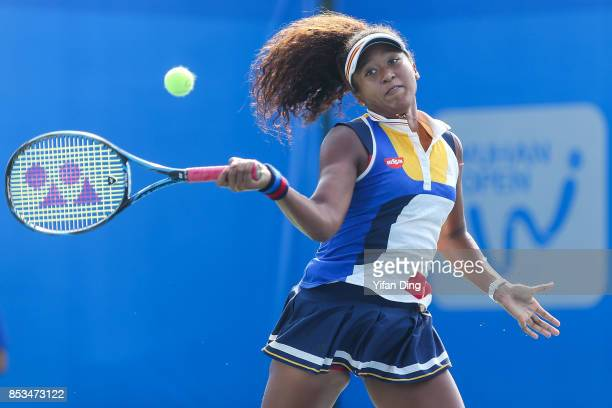 Naomi Osaka of Japan plays a forehand during the match against Elise Mertens of Belgium on Day 2 of 2017 Dongfeng Motor Wuhan Open at Optics Valley...