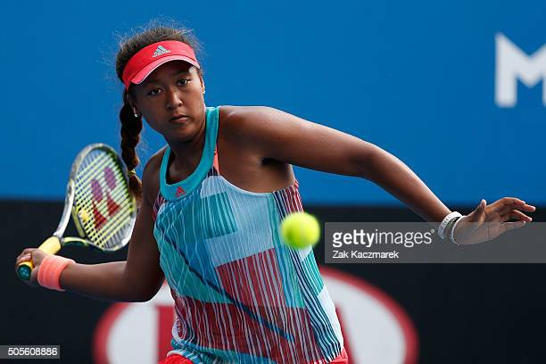 Naomi Osaka of Japan plays a forehand in her first round match against Donna Vekic of Croatia during day two of the 2016 Australian Open at Melbourne...