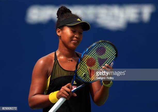 Naomi Osaka of Japan reacts after scoring a point against Karolina Pliskova of Czech Republic during Day 6 of the Rogers Cup at Aviva Centre on...