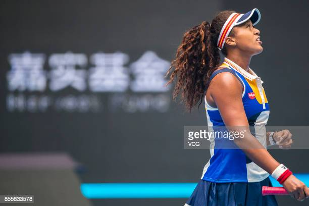 Naomi Osaka of Japan reacts against Angelique Kerber of Germany during the first round match of Women's singles match on day one of 2017 China Open...