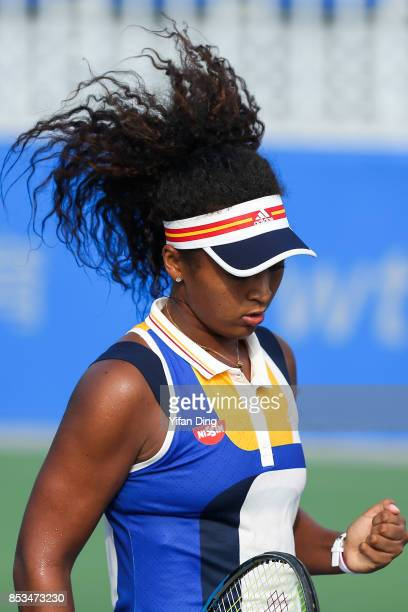 Naomi Osaka of Japan reacts during the match against Elise Mertens of Belgium on Day 2 of 2017 Dongfeng Motor Wuhan Open at Optics Valley...