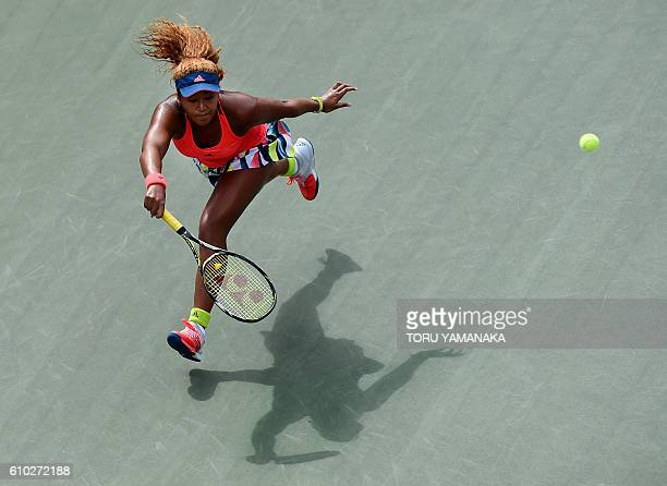 TOPSHOT Naomi Osaka of Japan returns a shot against Caroline Wozniacki of Denmark during their women's singles final match at the Pan Pacific Open...