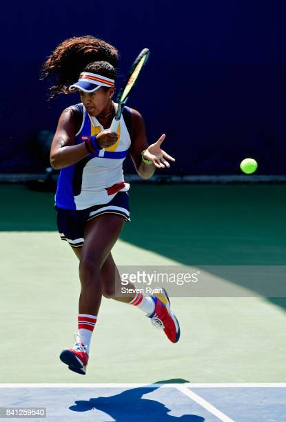 Naomi Osaka of Japan returns a shot against Denisa Allertova of Czech Republic during their second round Women's Singles match on Day Four of the...