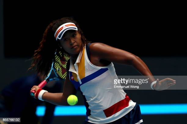 Naomi Osaka of japan returns a shot to Angelique Kerber of Germany on day one of the 2017 China Open at the China National Tennis Centre on September...