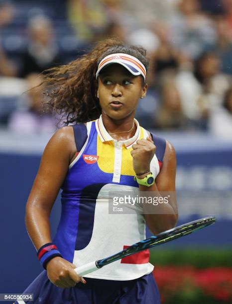 Naomi Osaka of Japan returns a shot to Angelique Kerber of Germany during their first round Women's Singles match on Day Two of the 2017 US Open at...