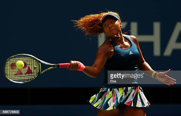 Naomi Osaka of Japan returns a shot to Madison Keys of the United States during her third round Women's Singles match on Day Five of the 2016 US Open...