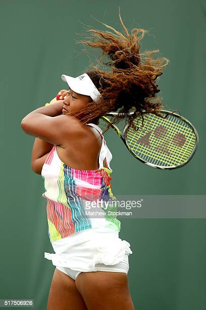 Naomi Osaka of Japan returns a shot to Sara Errani of Italy during the Miami Open presented by Itau at Crandon Park Tennis Center on March 25 2016 in...