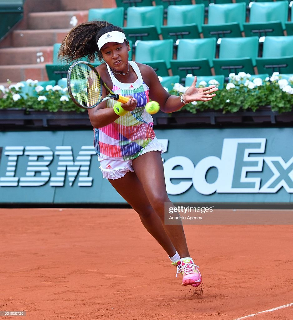 Naomi Osaka of Japan returns to Simona Halep (not seen) of Romania during women's single third round match at the French Open tennis tournament at Roland Garros Stadium in Paris, France on May 27, 2016.