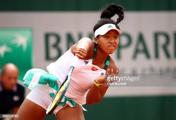 Naomi Osaka of Japan serves during the first round match against Alison Van Uytvanck of Belgium on day three of the 2017 French Open at Roland Garros...