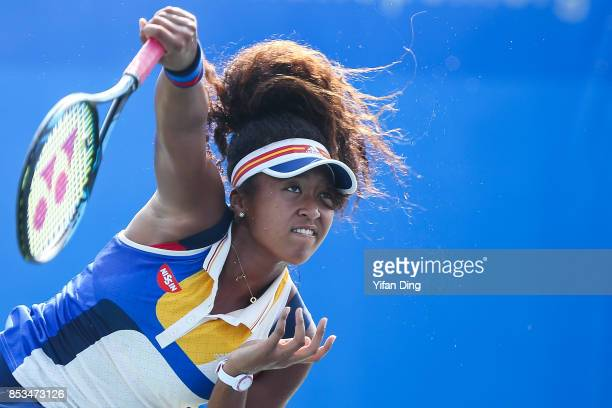 Naomi Osaka of Japan serves during the match against Elise Mertens of Belgium on Day 2 of 2017 Dongfeng Motor Wuhan Open at Optics Valley...