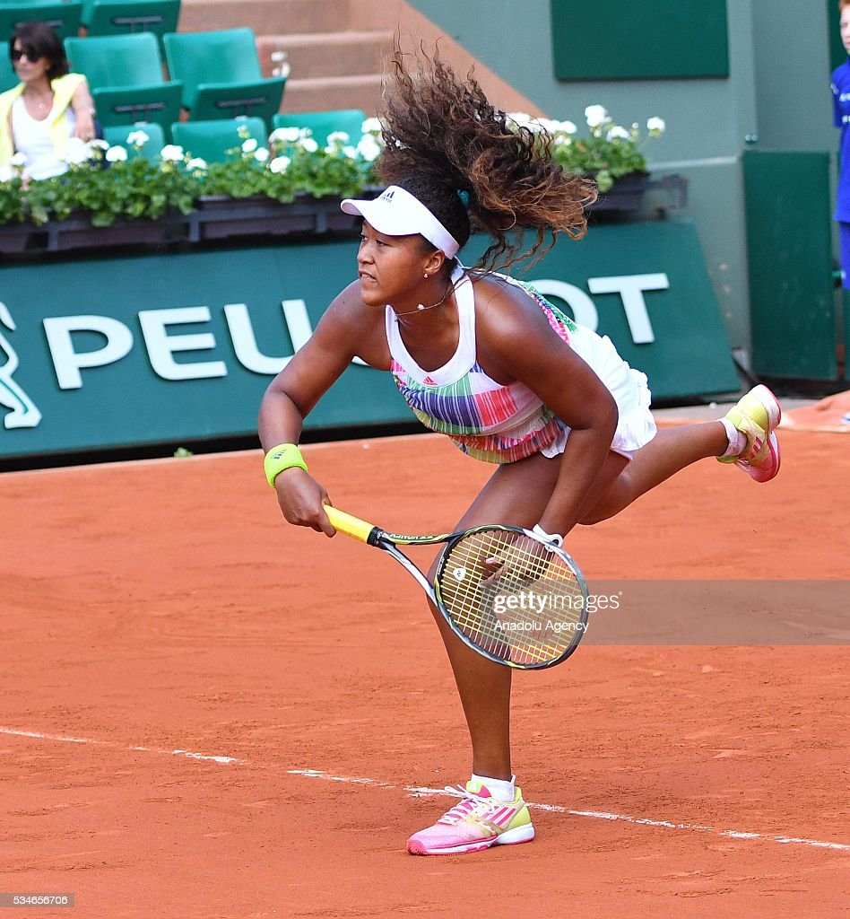 Naomi Osaka of Japan serves to Simona Halep (not seen) of Romania during the women's single third round match at the French Open tennis tournament at Roland Garros Stadium in Paris, France on May 27, 2016.