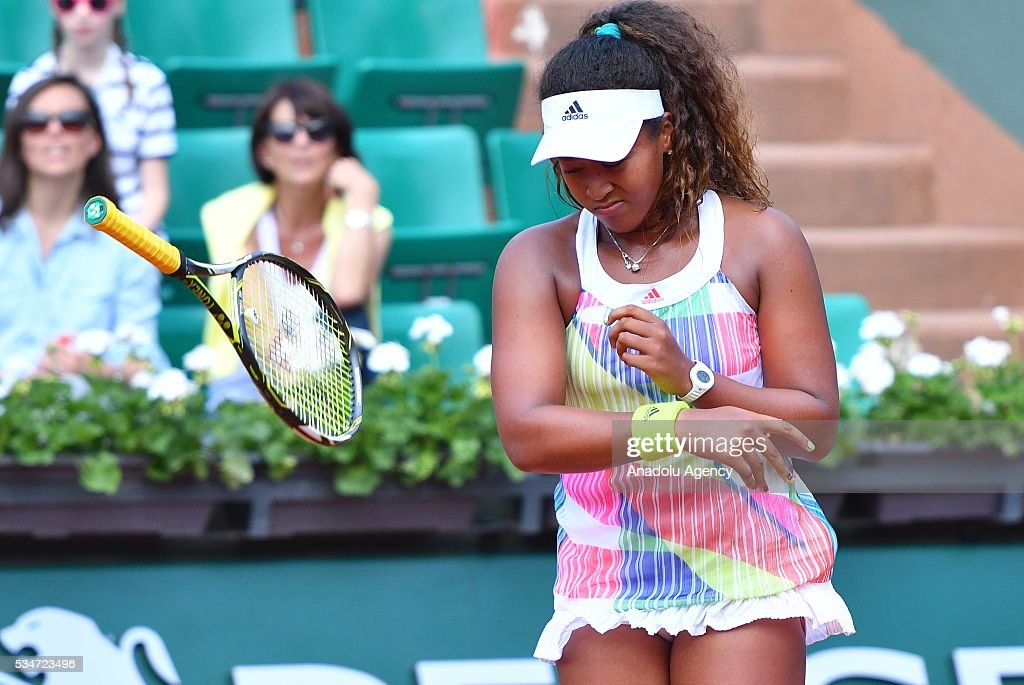 Naomi Osaka of Japan throws her racket during the women's single third round match against Simona Halep (not seen) of Romania at the French Open tennis tournament at Roland Garros Stadium in Paris, France on May 27, 2016.