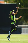 Naomi Stalenberg of the Thunder celebrates taking a catch to dismiss Sara Hungerford of the Sixers during the Women's Big Bash League match between...