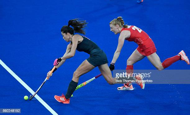 Naomi van As of the Netherlands is challenged by Nicola White of Great Britain during the Women's hockey Gold medal match between The Netherlands and...