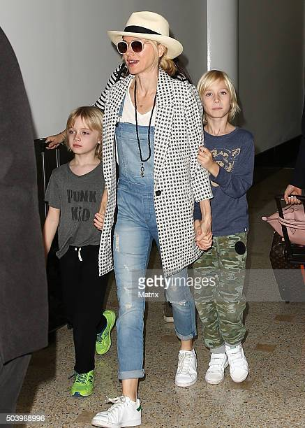 Naomi Watts pictured on arrival into Sydney with her boys Alexander and Samuel on December 22 2015 in Sydney Australia