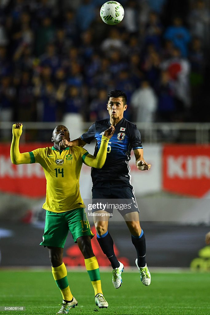 Naomichi Ueda of Japan and Given Motupa of South Africa compete for the ball during the U-23 international friendly match between Japan v South Africa at the Matsumotodaira Football Stadium on June 29, 2016 in Matsumoto, Nagano, Japan.