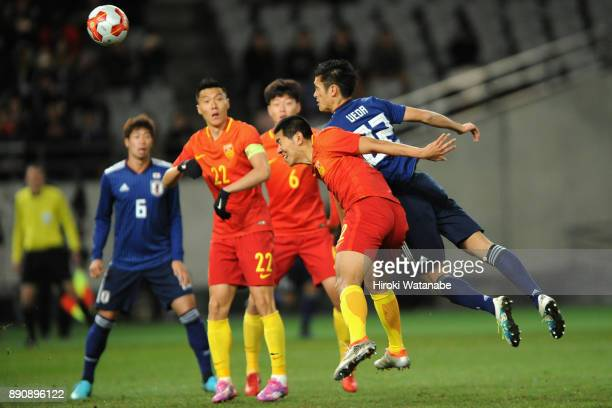 Naomichi Ueda of Japan dives for the ball during the EAFF E1 Men's Football Championship between Japan and China at Ajinomoto Stadium on December 12...