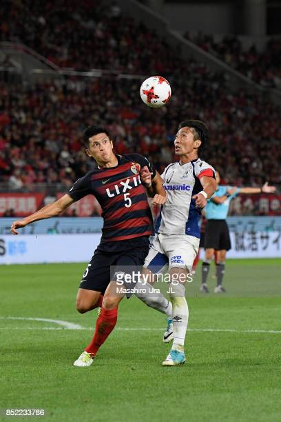 Naomichi Ueda of Kashima Antlers and Shun Nagasawa of Gamba Osaka compete for the ball during the JLeague J1 match between Kashima Antlers and Gamba...