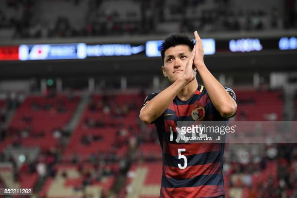 Naomichi Ueda of Kashima Antlers applaud supporters after his side's 21 victory in the JLeague J1 match between Kashima Antlers and Gamba Osaka at...