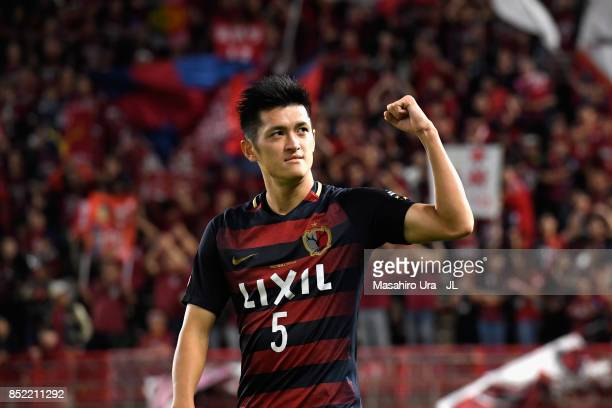 Naomichi Ueda of Kashima Antlers applauds supporters after his side's 21 victory in the JLeague J1 match between Kashima Antlers and Gamba Osaka at...