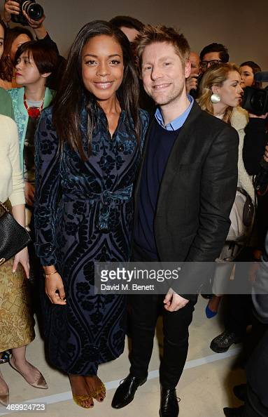 Naomie Harris and Christopher Bailey pose backstage after the Burberry Womenswear Autumn/Winter 2014 show at Kensington Gardens on February 17 2014...