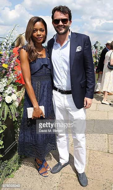 Naomie Harris and guest attend the Royal Salute Coronation Cup at Guards Polo Club on July 23 2016 in Egham England