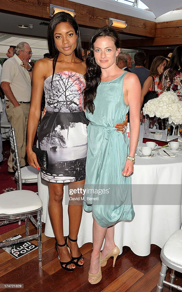 Naomie Harris (L) and Lara Pulver attend the Audi International Polo at Guards Polo Club on July 28, 2013 in Egham, England.
