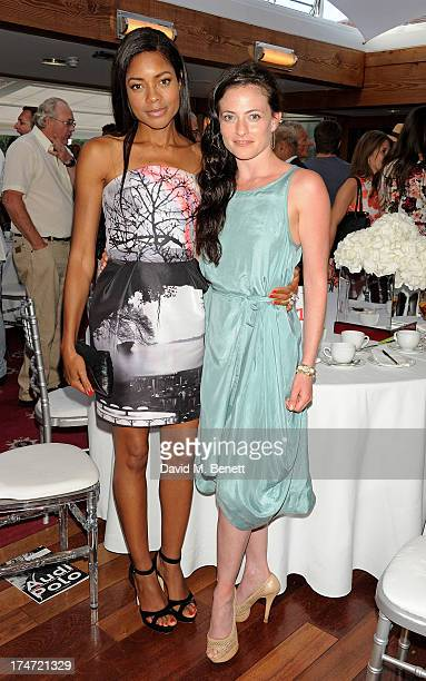 Naomie Harris and Lara Pulver attend the Audi International Polo at Guards Polo Club on July 28 2013 in Egham England