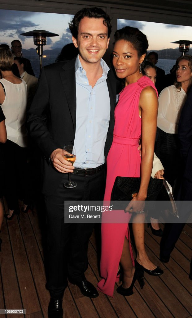 Naomie Harris (R) and Peter Legler attend the annual Finch's Quarterly Review Filmmakers Dinner hosted by Charles Finch, Caroline Scheufele and Nick Foulkes at Hotel Du Cap Eden Roc on May 17, 2013 in Antibes, France.