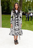 Naomie Harris arrives at Burberry Womenswear Spring/Summer 2016 show during London Fashion Week at Kensington Gardens on September 21 2015 in London...