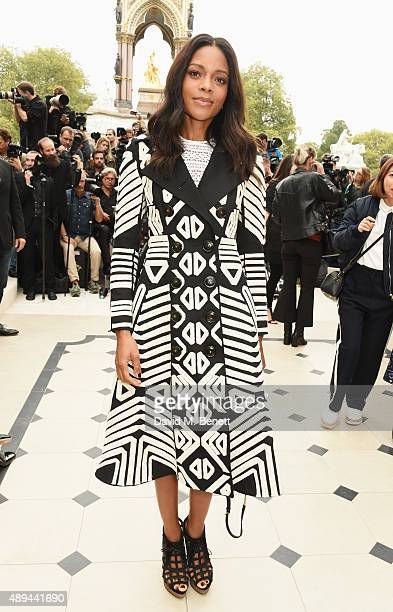 Naomie Harris attend the Burberry Womenswear Spring/Summer 2016 show during London Fashion Week at Kensington Gardens on September 21 2015 in London...