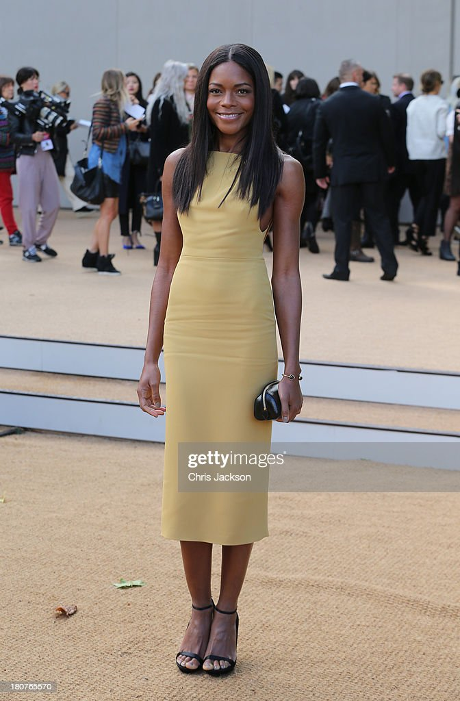 Naomie Harris attends the Burberry Prorsum show at London Fashion Week SS14 at Kensington Gardens on September 16, 2013 in London, England.