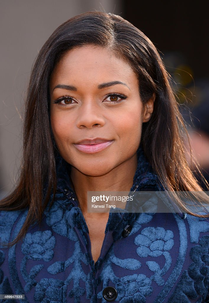 Naomie Harris attends the Burberry Prorsum show at London Fashion Week AW14 at Kensington Gardens on February 17, 2014 in London, England.