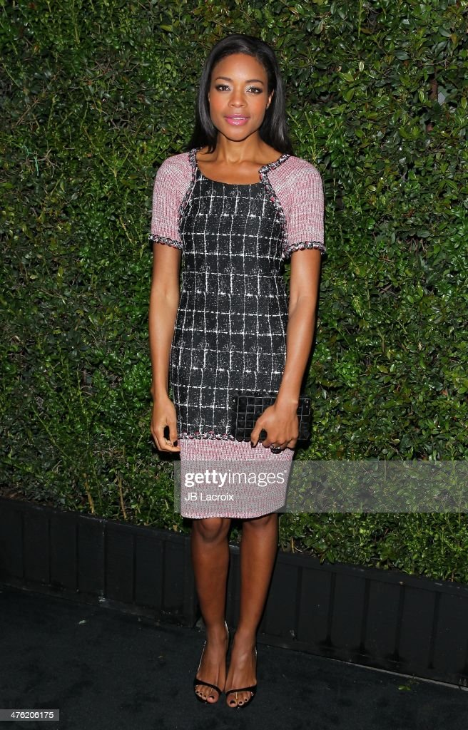 Naomie Harris attends the Chanel Charles Finch Pre-Oscar Dinner held at Madeo Restaurant on March 1, 2014 in Los Angeles, California.